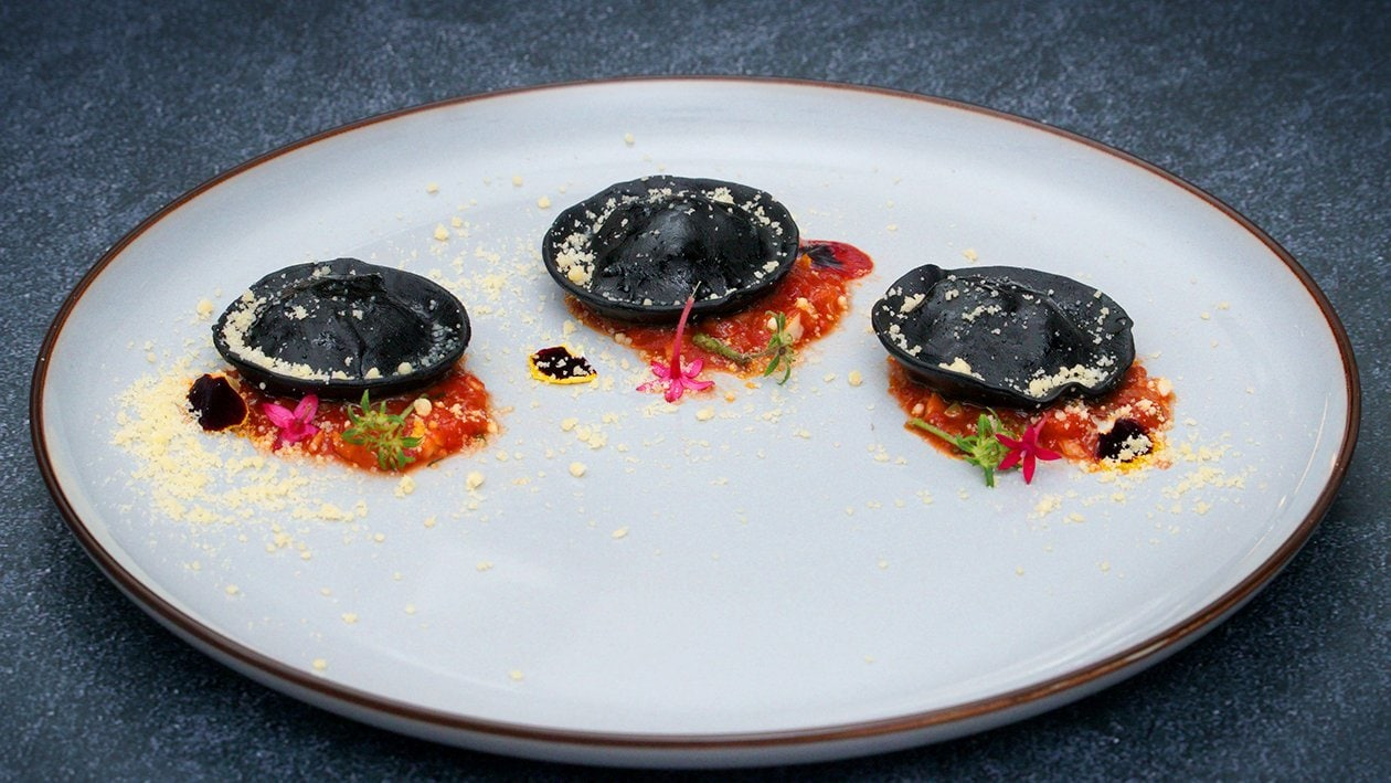 Black Squid Ink Ravioli with Szechuan Grilled Chicken Filling